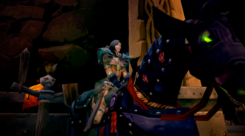 Cynwise, mounted on the Headless Horseman's Mount, stands in front of one of the Ironforge Training dummies.